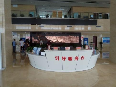 山东省滨州市无棣县某单位大厅7.38米×2.6米紫铜浮雕红木屏风